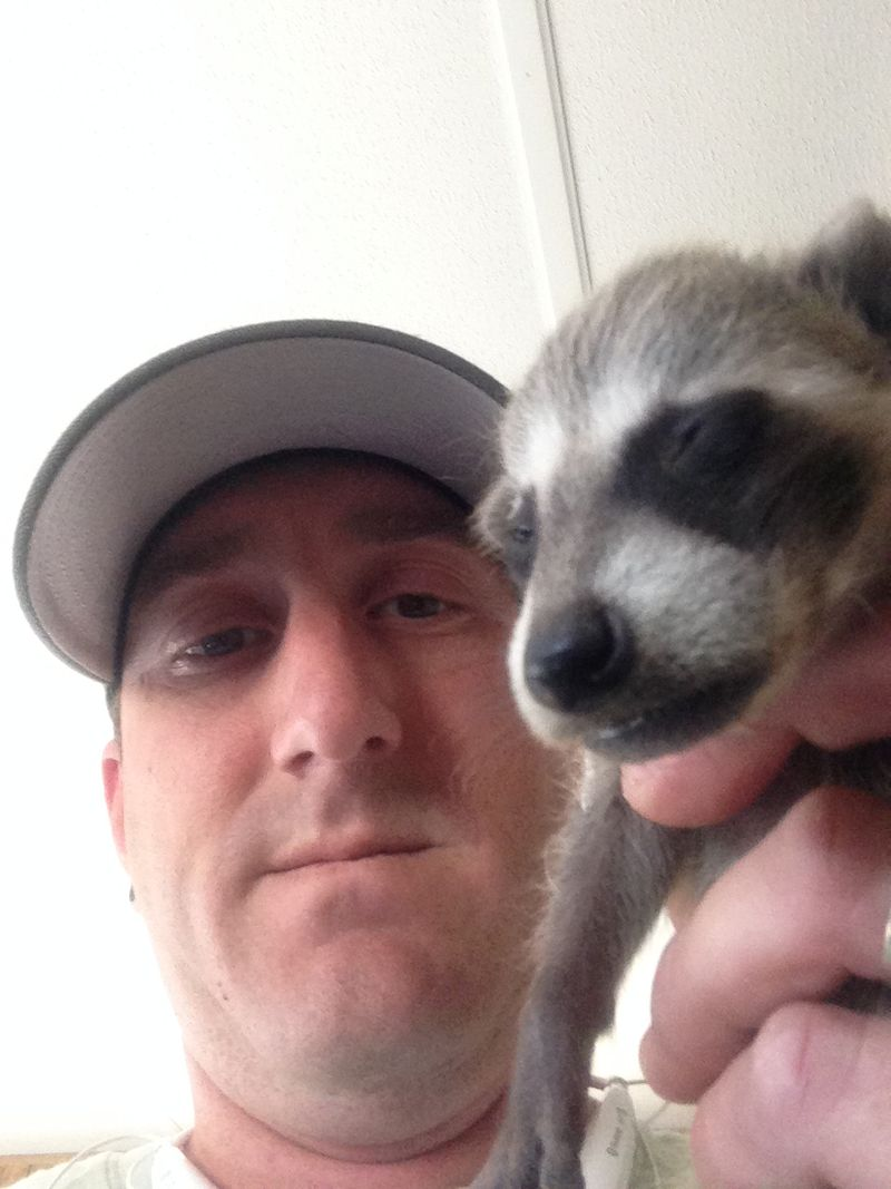 Josh Waling with Raccoon Kit